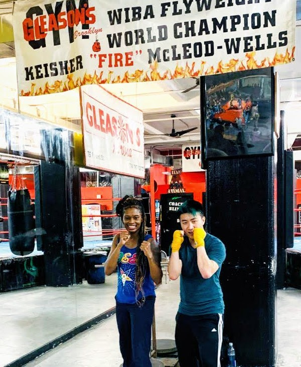 Posing with Boxing Flyweight Champion Keisher 'Fire' McLeod-Wells